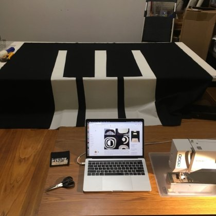 """This is my workspace. I pulled up my blog on my Macbook Pro and that's my trusty Bernina 160 (circa 2000) on the right. I had just finished sewing and ironing the top piece of the """"keys."""""""